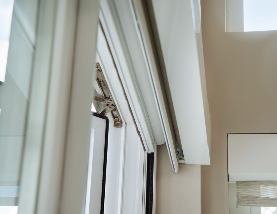 Window screens that retract out of sight.