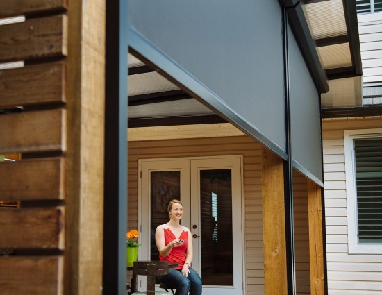 Block the sun and bugs with Phantom motorized screens for porches and patios
