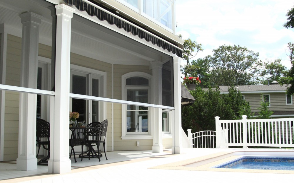 Phantom's motorized retractable Executive screens deliver protection from the sun and the bugs at this New Jersey home.