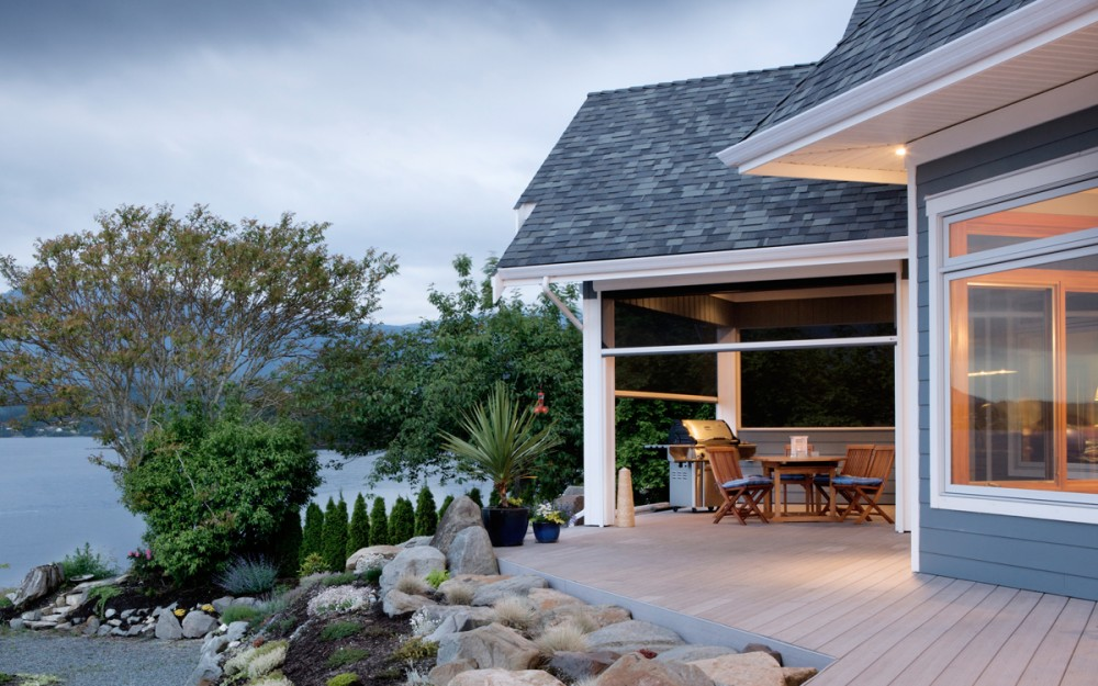 Don't block your beautiful ocean view - keep the bugs out and enjoy the summer breeze with Phantom motorized screens